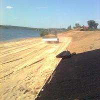 Paplūdimio formavimas buldozeriu